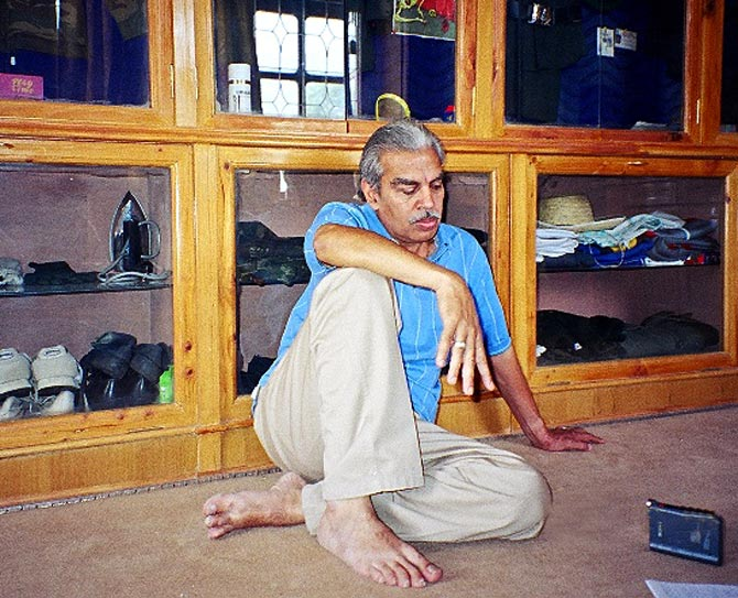 Dr N K Kalia, sitting in a room full of his son's personal items that were returned to him, a photograph shot in 2004.