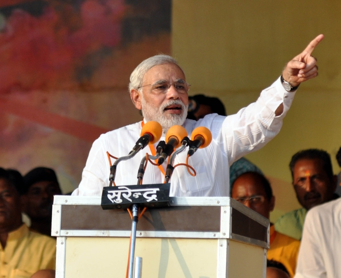 Gujarat Chief Minister Narendra Modi addresses a rally at Kanpur
