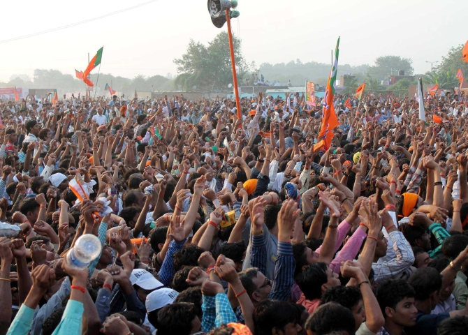 The crowd cheers for Modi