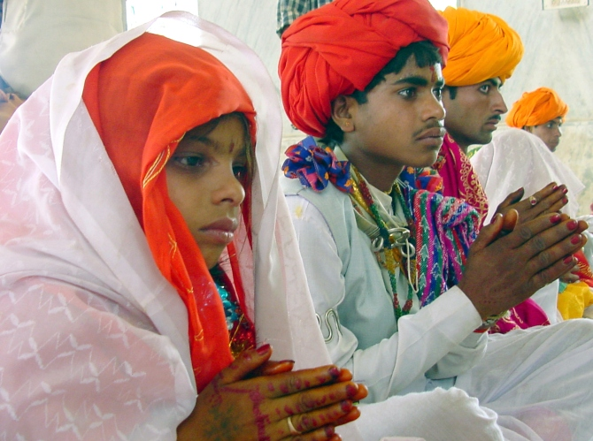 Sheela, 8, sits besides her 14-year-old groom Daulat Ram during their marriage ceremony