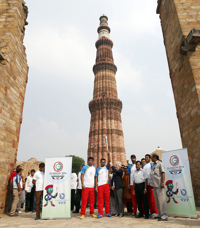 Indian hockey player Dharamvir Singh holds the Commonwealth Games Baton which arrived in India before the Commonwealth Games in Glasgow in 2014.