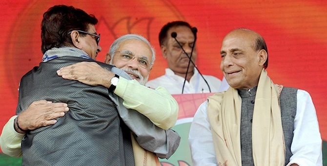 Modi hugs Shatrughan Sinha as BJP chief Rajnath Singh watches on