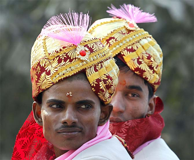 Grooms at a mass marriage ceremony in Noida, UP.