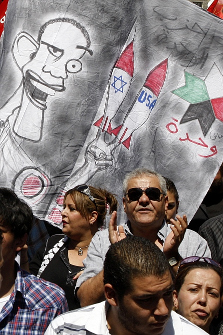 Protesters from leftist parties demonstrate against military strikes on the Syrian government and to show their support for the regime of Syria's President Bashar al-Assad, after Friday prayers in Amman