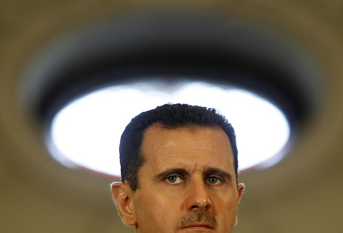 Syria's President Bashar al-Assad attends a news conference