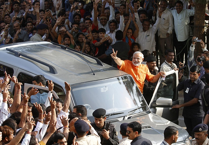 Gujarat state Chief Minister Narendra Modi gestures as he arrives to cast his vote during the second phase of state elections in Ahmedabad