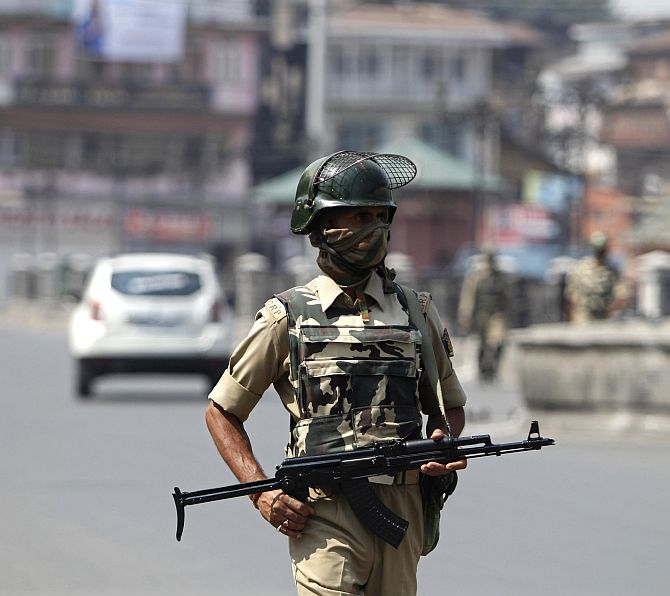 A policeman patrols a street during a strike called by separatists against the concert by the Bavarian State Orchestra and renowned conductor Zubin Mehta, in Srinagar