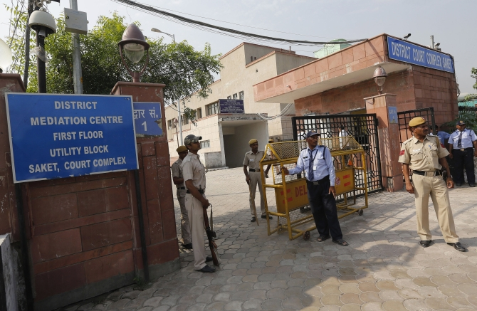 Policemen stand guard outside the Saket court in New Delhi where the gang-rape case verdict was delivered on Tuesday