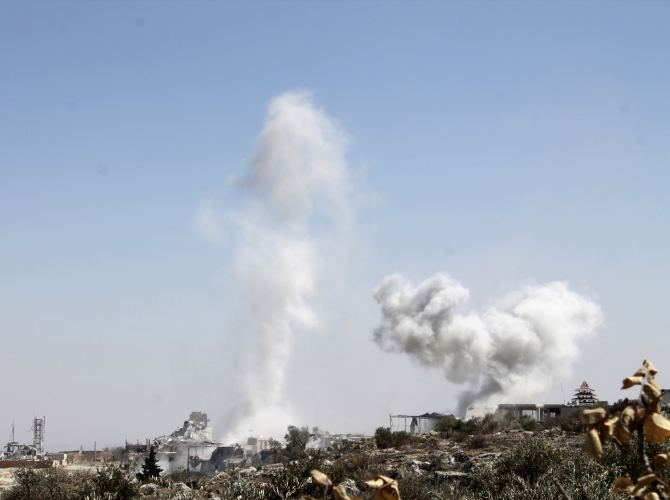 Smoke rises as a result of shelling from forces loyal to President Bashar al-Assad, according to activists, in Ariha countryside