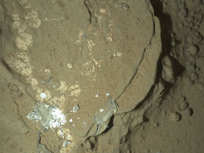 A Martian rock illuminated by white LEDs is pictured in this NASA photo