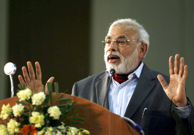 Gujarat Chief Minister Narendra Modi speaks during the concluding session of the Vibrant Gujarat Global Investors' Summit 2011 at Gandhinagar