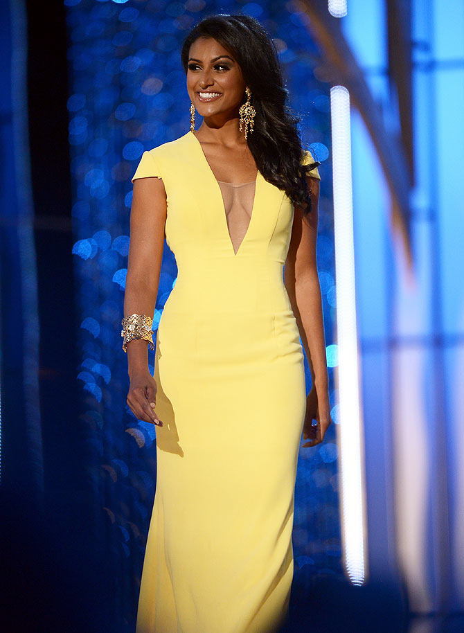 Nina Davuluri performs in the evening gown portion of the 2014 Miss America Competition at Boardwalk Hall Arena, New Jersey
