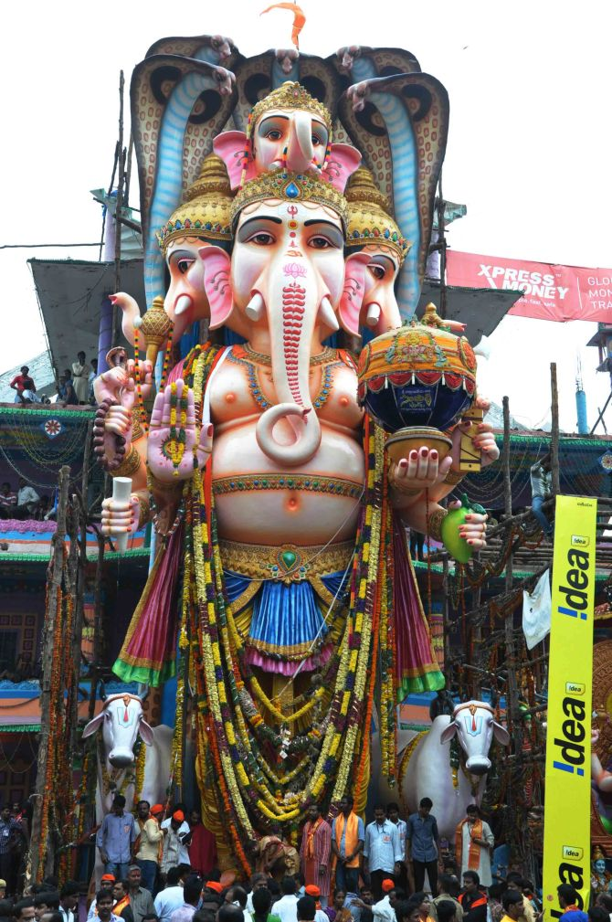 The Khairatabad Ganesh idol with the huge ladoo in his hand.