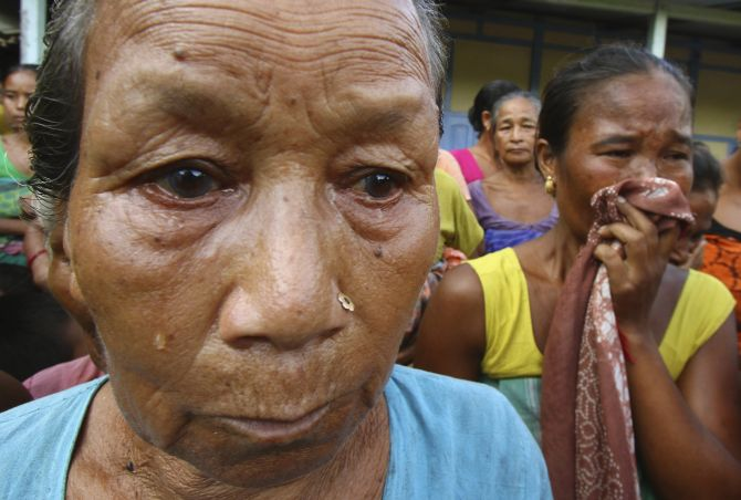 Women affected by the ethnic riots in Assam cry at a relief camp at Goshaigaon town in July, 2012.