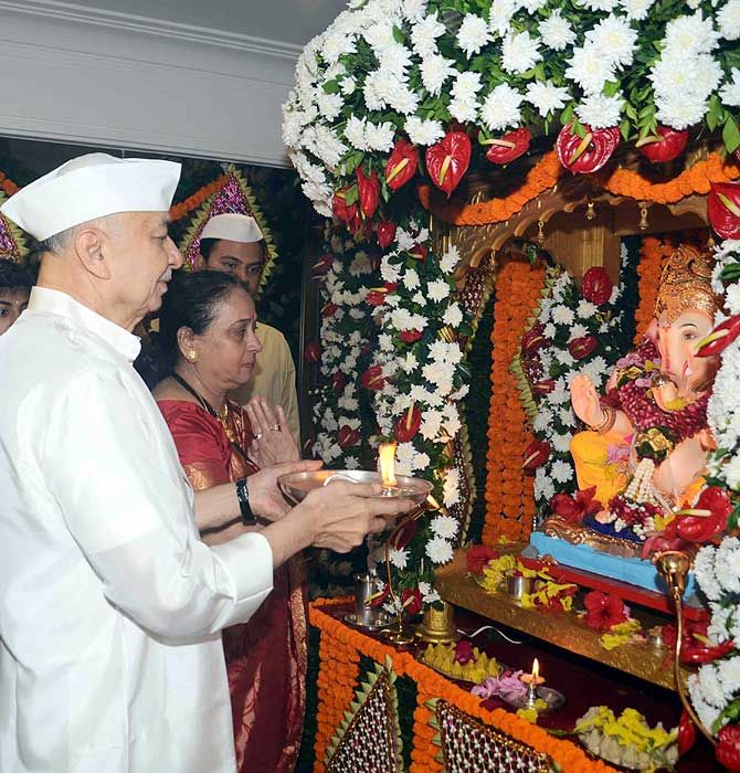 Union Home Minister Sushilkumar Shinde participates in Ganpati puja at his residence in Pali Hill in Bandra, Mumbai.