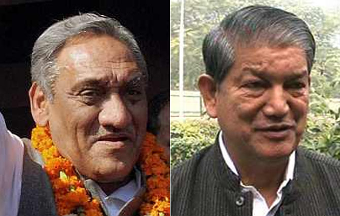 Uttarakhand Chief Minister Vijay Bahuguna (left) and Union Minister Harish Rawat