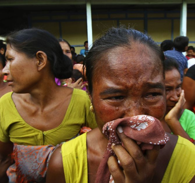 A woman affected by ethnic riots in Assam in 2012 cries after her house was burnt during violence, at a relief camp at Goshaigaon town.