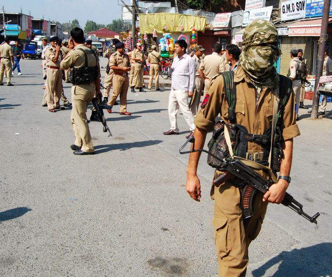 CISF and J&K Police personnel cordon of the site of a militant strike in Srinagar on Monday