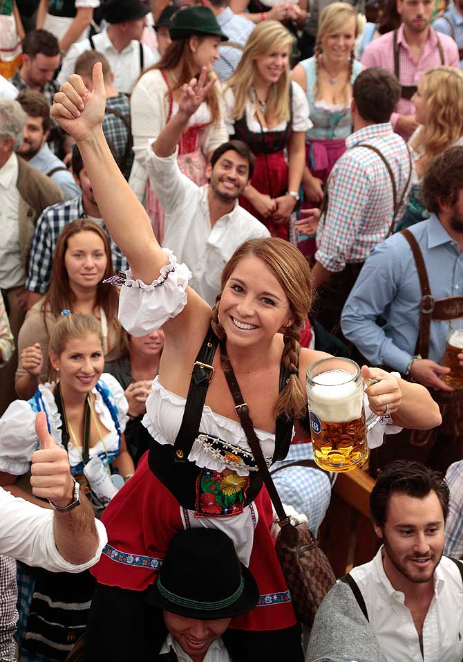 Revellers reach for the first beer mug at Hofbraeuhaus beer tent during day 1 of the Oktoberfest 2013 beer festival at Theresienwiese on September 21, 2013 in Munich, Germany. The Munich Oktoberfest, which this year will run from September 21 through October 6, is the world's largest beer fest and draws millions of visitors.
