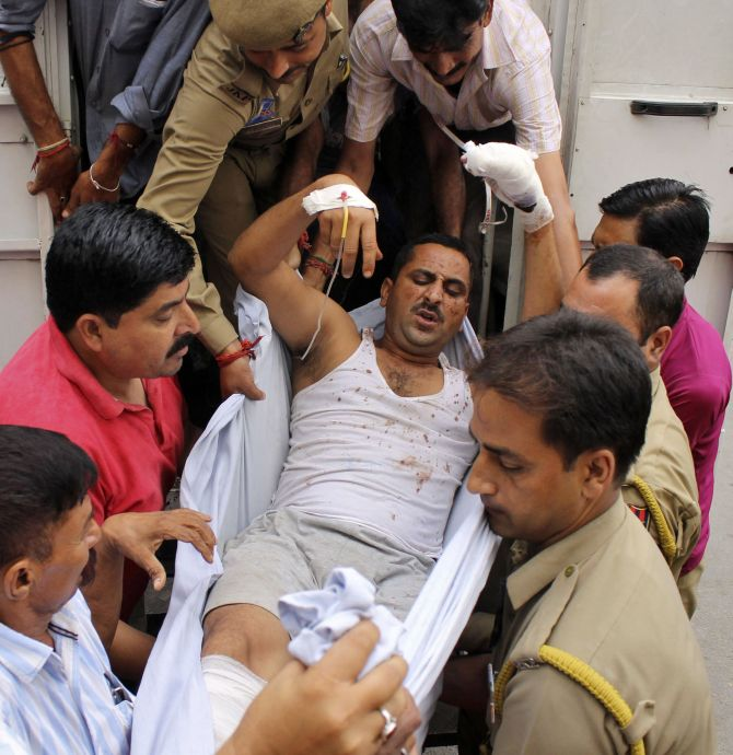 A policeman injured in a fidayeen strike is rushed to a hospital for treatment, in Jammu.