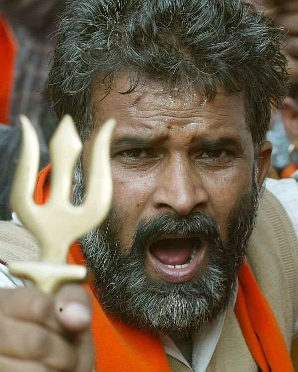 A Hindu activist brandshes a small trident during a demonstration