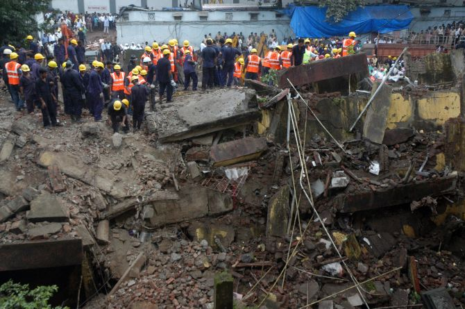 Firefighters and rescue workers at the site of building collapse