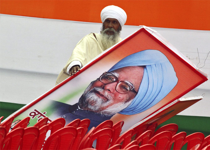 A supporter with a billboard of Dr Manmohan Singh in Punjab, January 19, 2012.