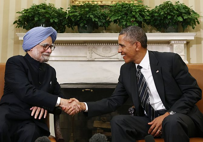 Obama shakes hands with Dr Singh in the Oval Office of the White House