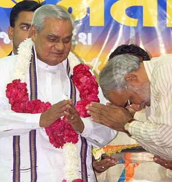 Narendra Modi, then Gujarat's chief minister, pays obeisance to then prime minister Atal Bihari Vajpayee