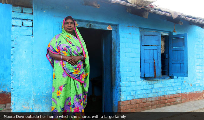 Meera Devi outside her home which she shares with a large family