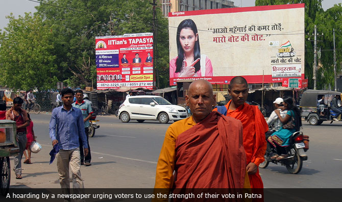 A hoarding by a newspaper urging voters to use the strength of their vote