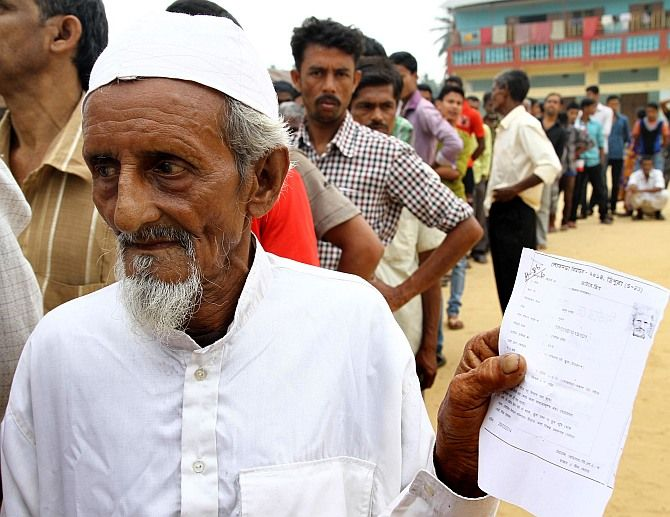A Muslim voter waits to cast his vote during an election