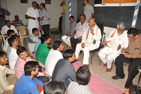 VHP General Secretary Kiritbhai Mistry (standing, left, in a white outfit) and S D Jani (extreme right, in brown shirt) and VHP International Working President Pravin Togadia at a meeting on the night of April 19.