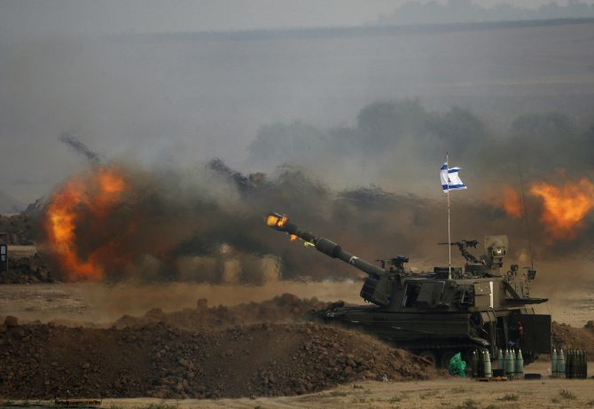 An Israeli mobile artillery unit fires towards the Gaza Strip.
