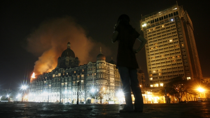 Smoke emerges from the Taj Mahal Hotel in Mumbai, in this photograph shot in the early hours of November 27, 2008.