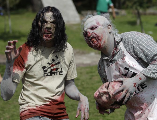 Men dressed as zombies take part in the Run for Your Lives 4 km obstacle course race in El Ajusco, on the southern outskirt of Mexico City.