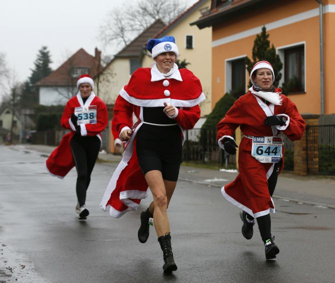 Competitors run in the Nikolaus Run (Santa Claus Run) in the east German town of Michendorf, some 40 km southwest of Berlin.