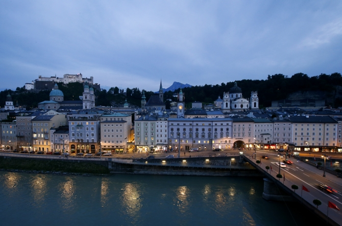 A general view shows the city of Salzburg next to river Salzach during a summer evening.