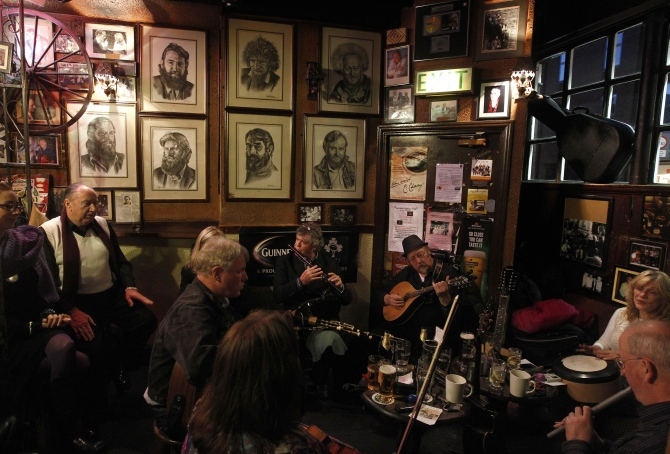 Musicians play Irish traditional music in a pub in central.