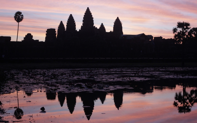 Cambodia's famous Angkor Wat temple is reflected in a pond during sunrise in Siem Reap.