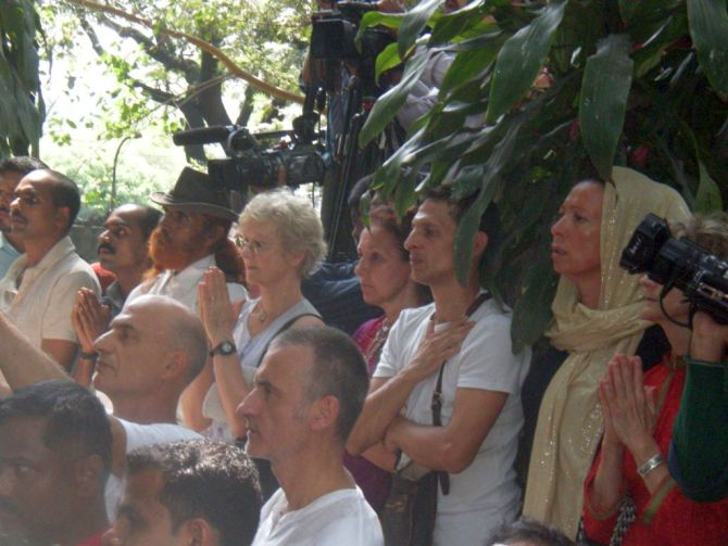 The yogacharya's disciples pay their last respects at the crematorium in Pune