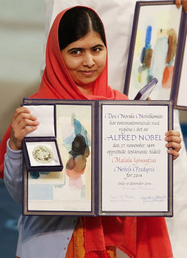 Nobel Peace Prize Laureate Malala Yousafzai with the medal and diploma during the Nobel Peace Prize ceremony in Oslo. Photograph: Suzanne Plunkett/Reuters