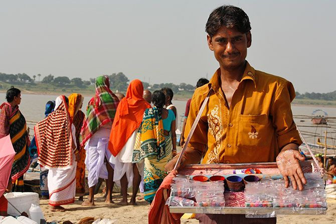 A bindi seller shows off his wares