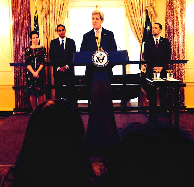 US Secretary of State John F Kerry at the swearing-in. Ambassador Richard Verma and his wife Pinky can be seen on the left, back row.