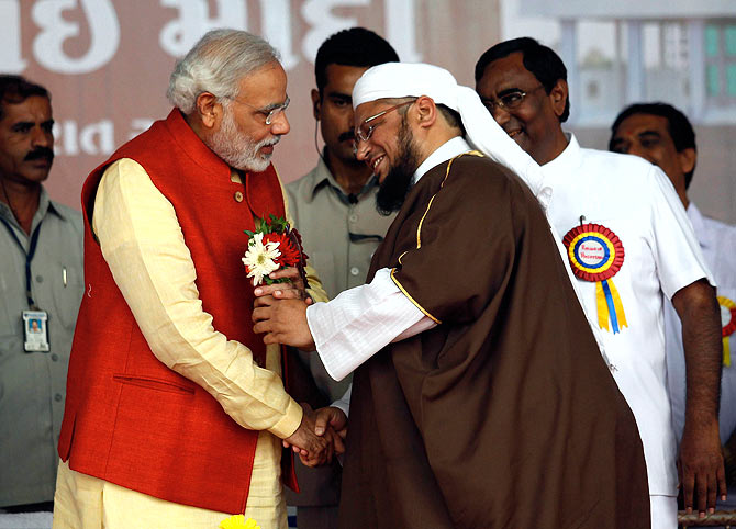 Narendra Modi with a Muslim cleric after the inauguration of a hospital owned by a Muslim trust at Balasinore town, near Ahmedabad, November 10, 2013.