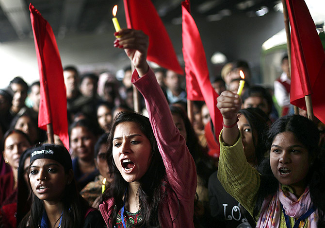 Protesters mark the first anniversary of the Delhi gang-rape, in New Delhi December 16, 2013.