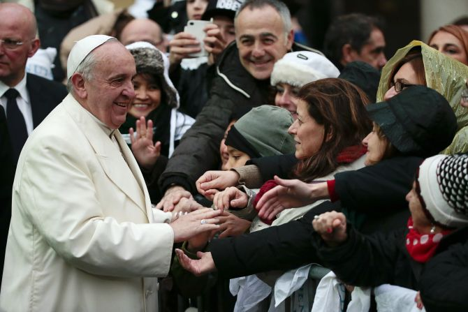 Pope Francis greets the faithful at the Sacro Cuore Basilica in Rome on Sunday, January 19.