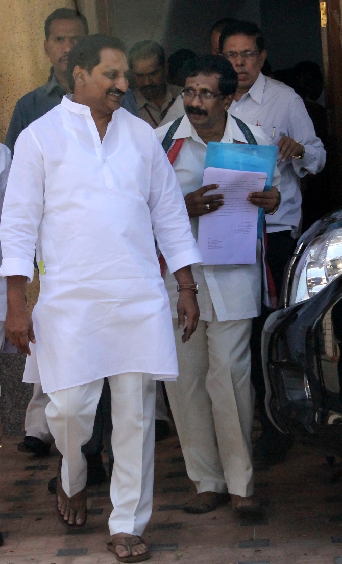 Andhra CM Kiran Kumar Reddy walks out of the assembly after the debate on Telangana