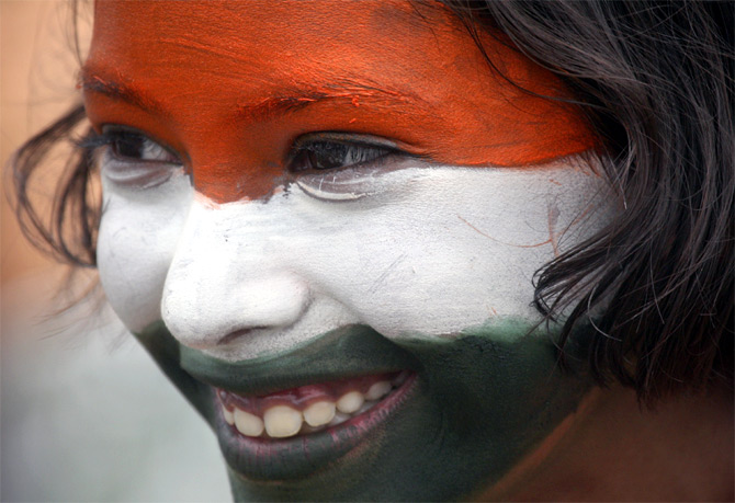 A school girl with her face painted in the colours of the national flag in Chandigarh.