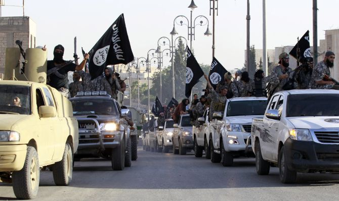 Daesh/Islamic State terrorists stage a military parade in Raqqa, northern Syria. Photograph: Reuters